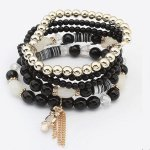P119899 Black bead elastic charm bracelet with dangling owl